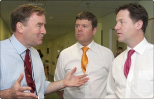 Dr Michael Pelly talks to Care Services Minister Paul Burstow and Deputy Prime Minister Nick Clegg on the Stroke Unit